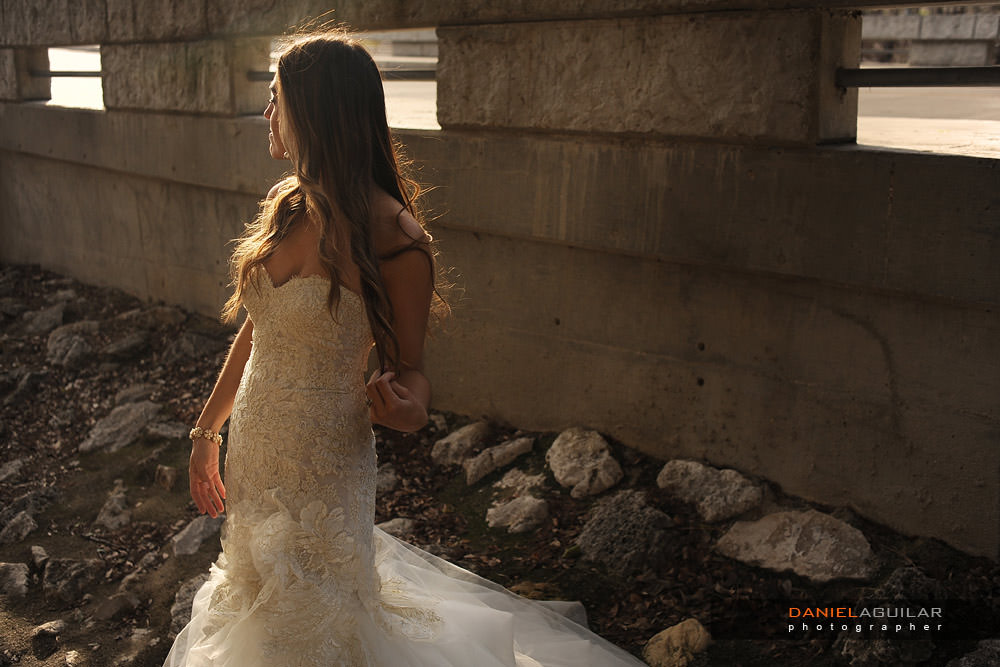 Beautiful sunset light portrait of a bride at the side of the street